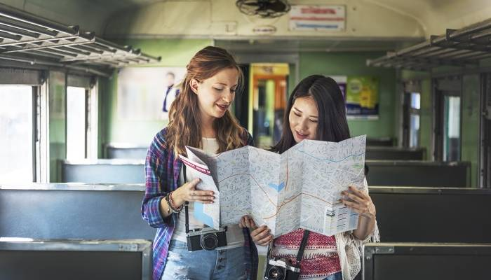 Picture of two women holding map